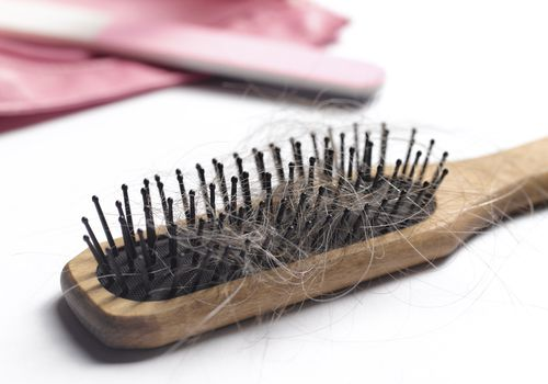 Hair brush with hair in it