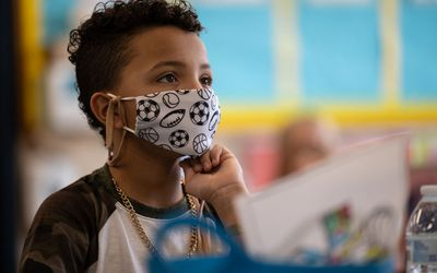 student masked in school