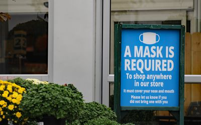 Mask required sign outside of a store.