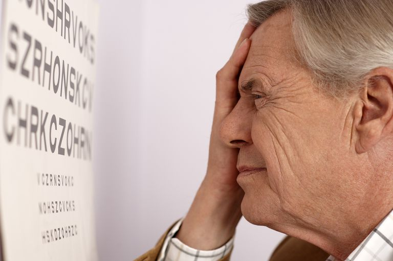 Man looking at eye chart