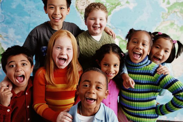 Group of kids standing in front of a world map