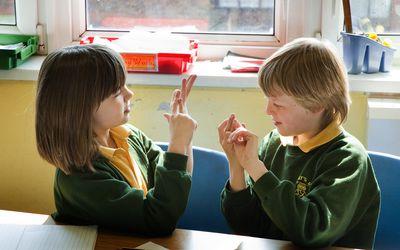 Deaf school children signing