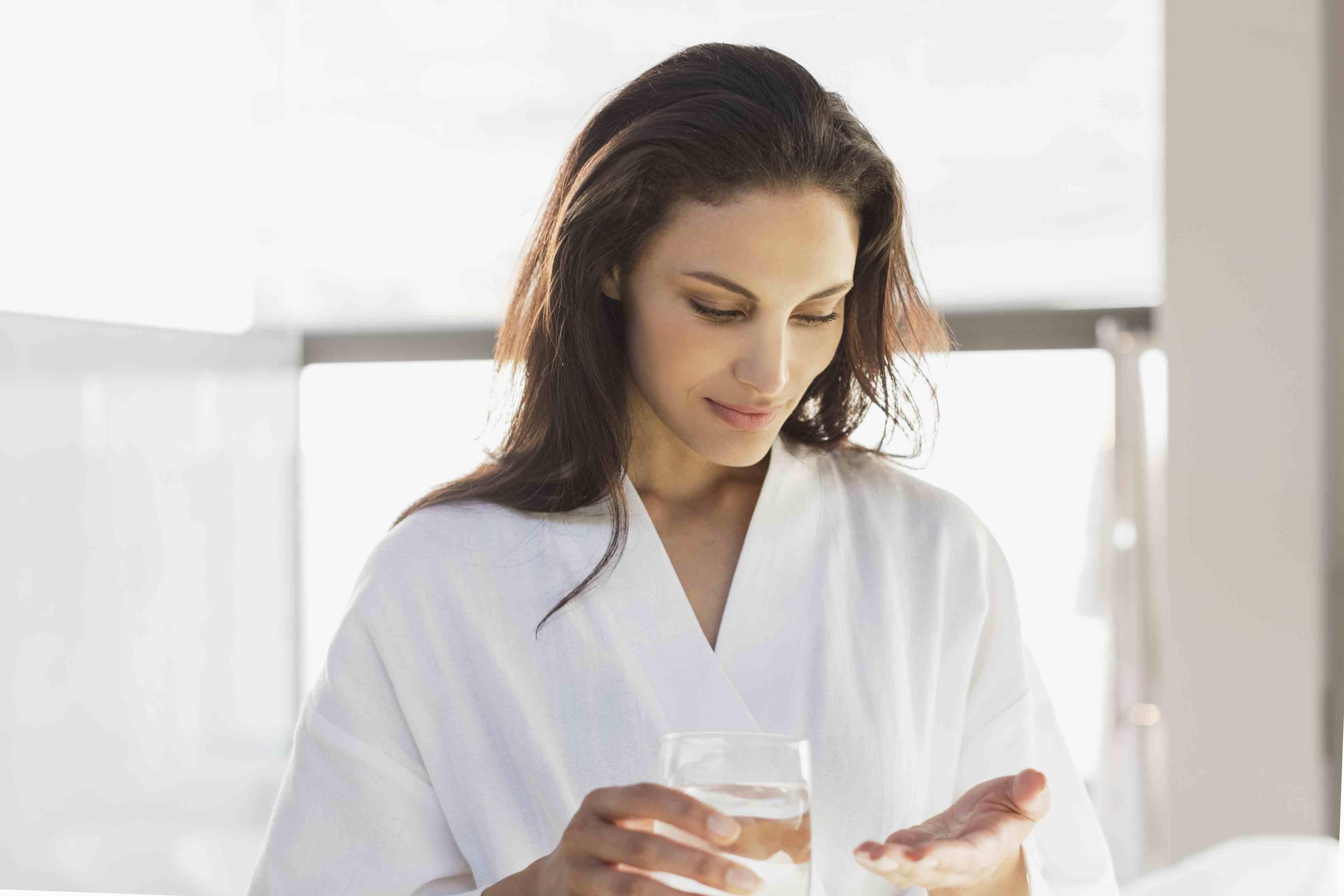 Woman taking a pill