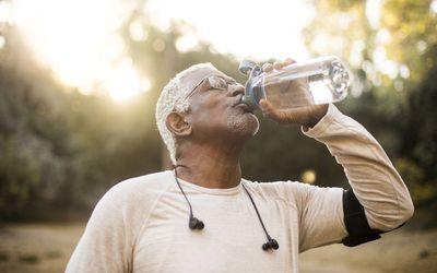 Senior African American Man Drinking Water