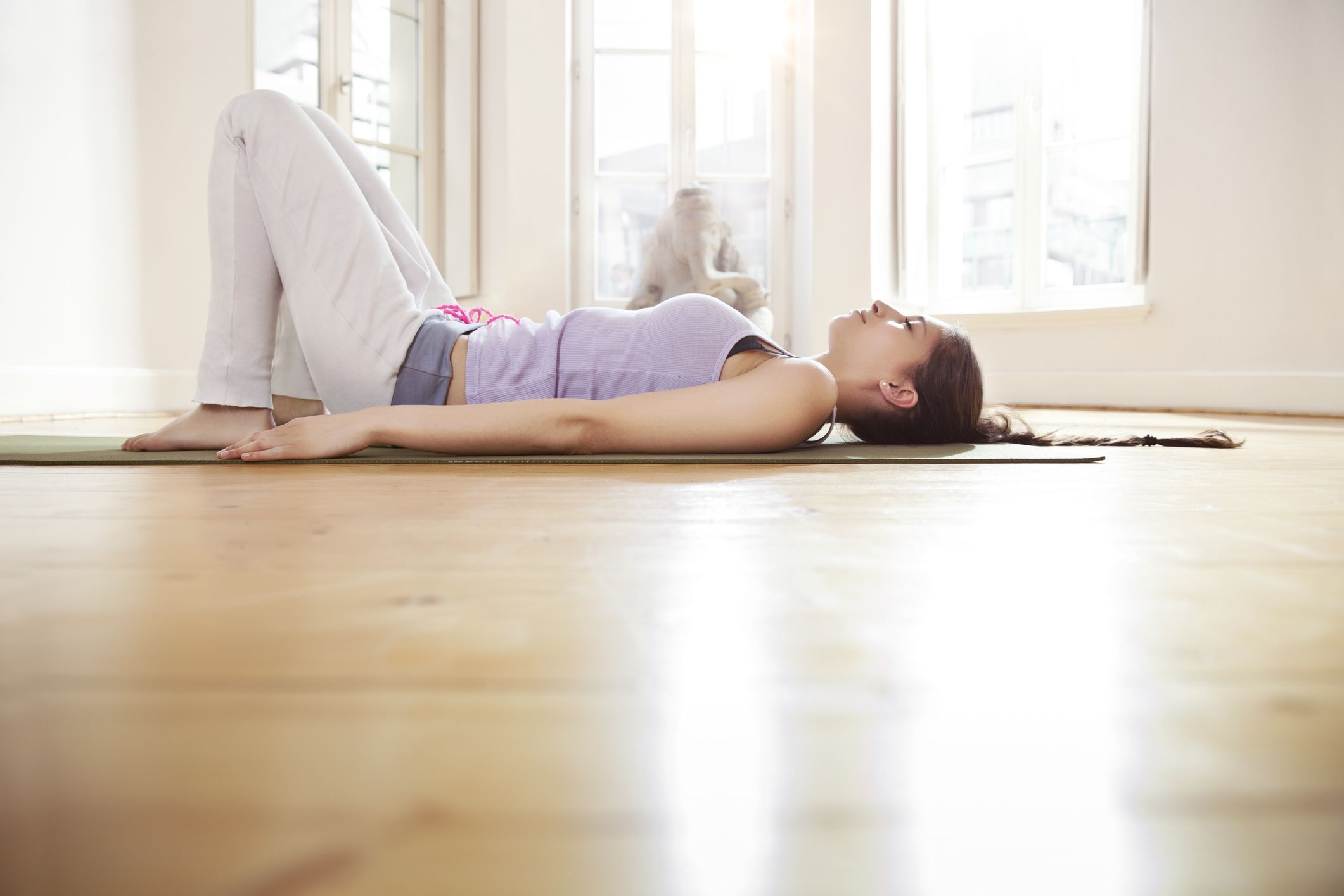 Woman laying on her yoga mat