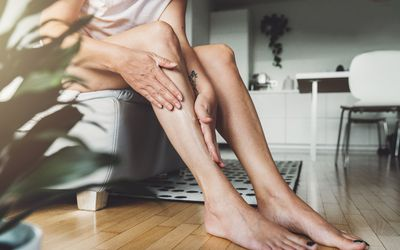 Person putting lotion on legs
