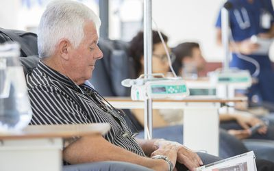 man reading during chemo treatment
