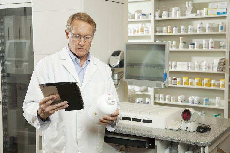 A male pharmacist at work