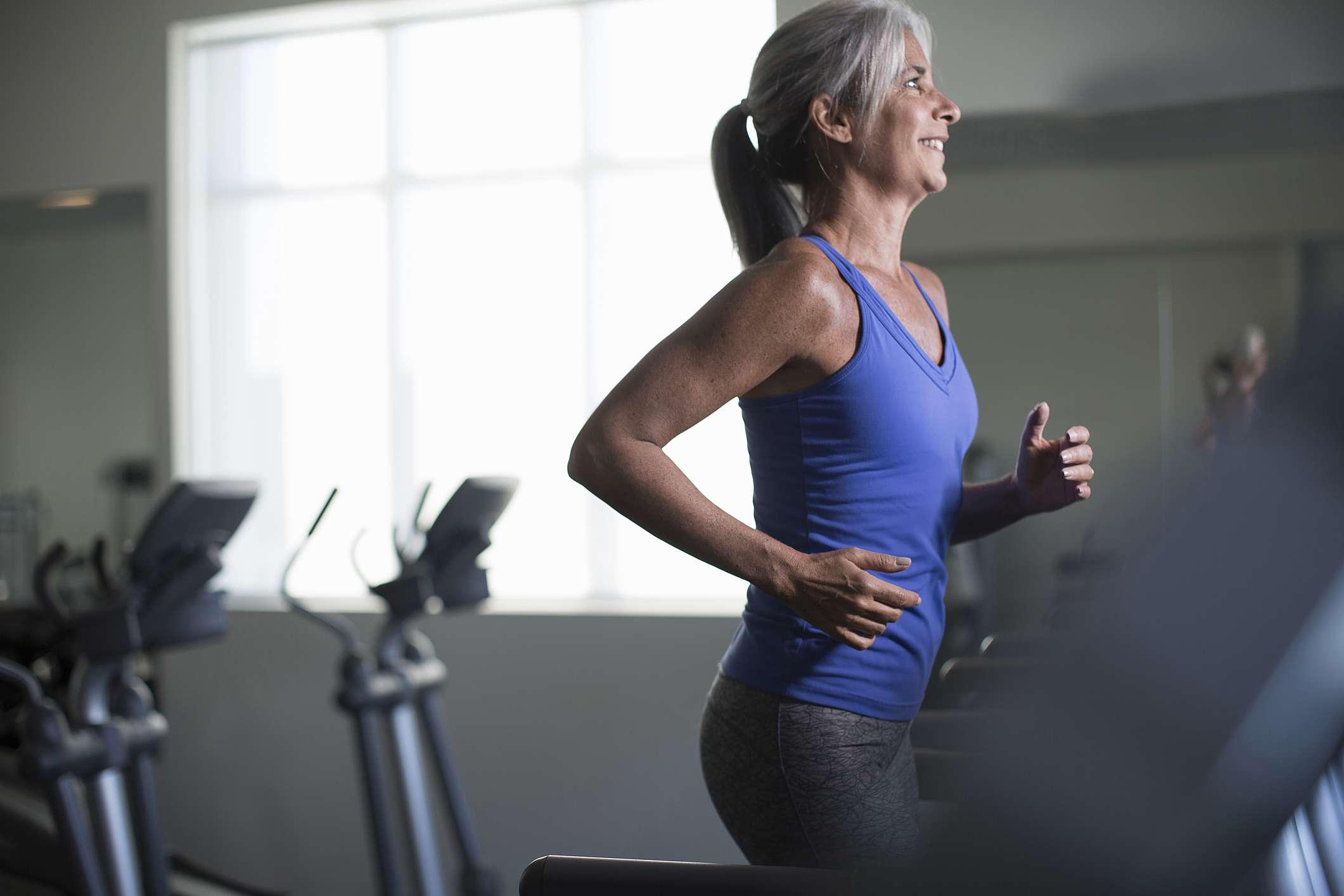 mature woman running on treadmill