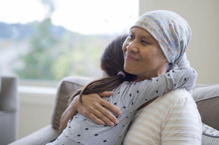 A cancer patient hugging her granddaughter