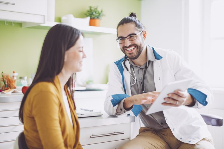 Woman speaking with doctor before exam
