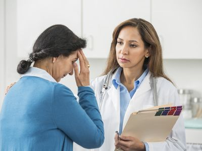 Doctor and woman who has shingles on face