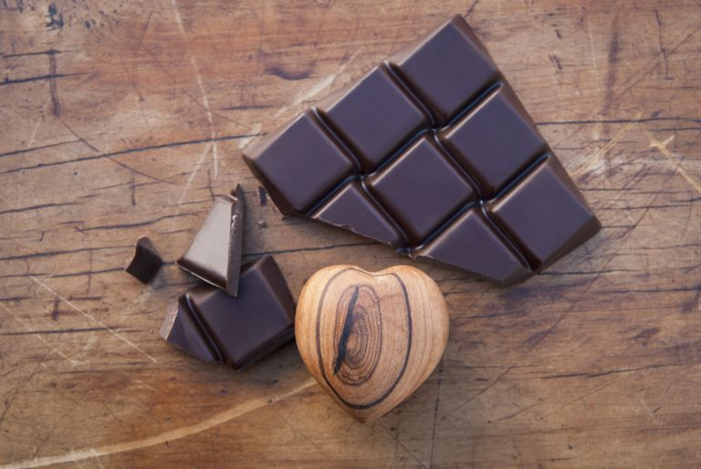 slab of dark chocolate and a wooden heart