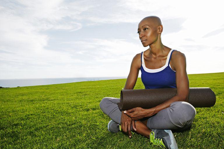 bald women doing yoga