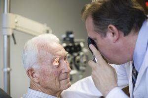Eye doctor checking man's eyes