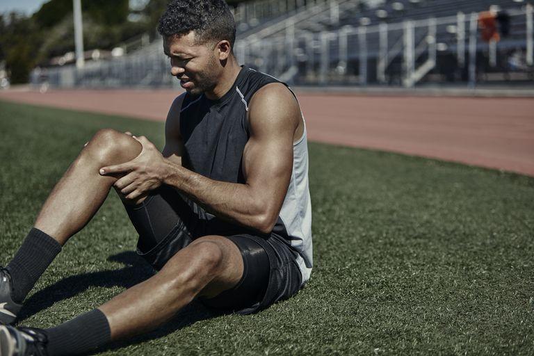 Track Runner holding his leg in pain