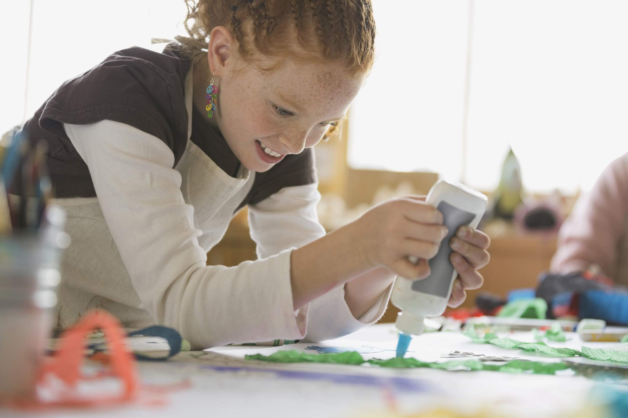 A girl glueing a craft project