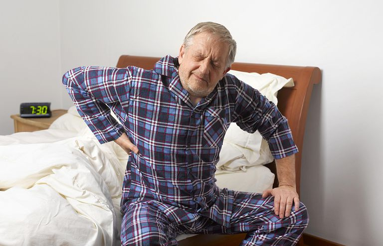 Man with back pain in bed