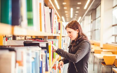College student in library