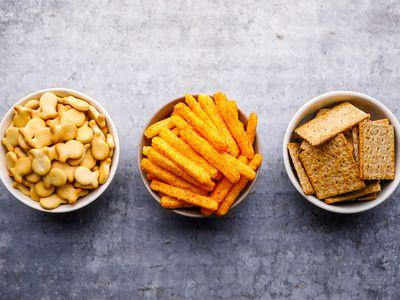 Bowls of goldfish, cheetos, and graham crackers