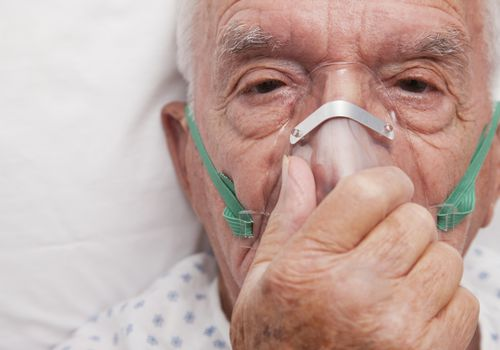 man with an oxygen mask