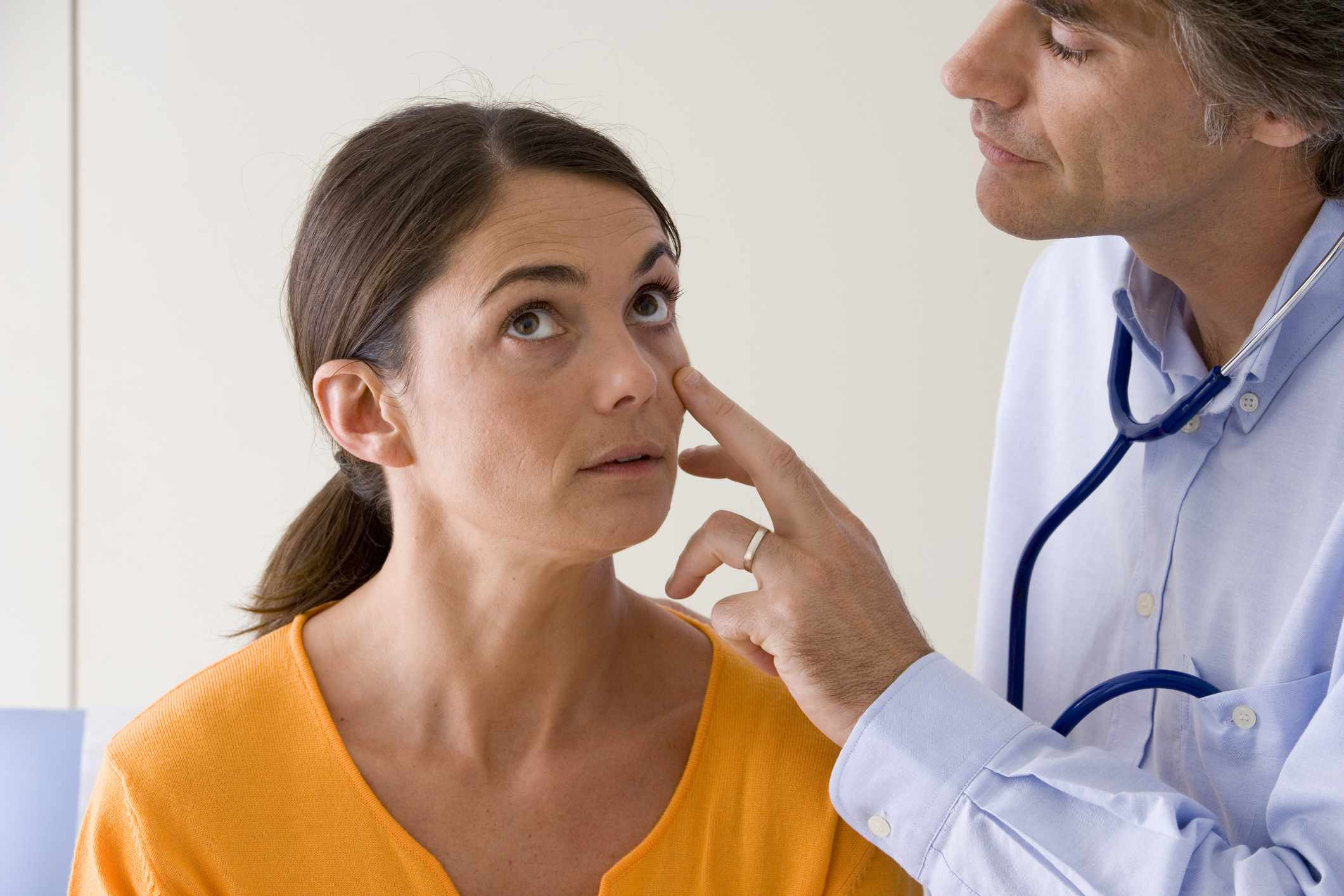 A woman being examined by a doctor for anemia