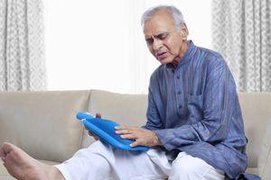 Senior man suffering from knee pain