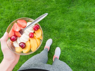 a person holding a bowl of fruit