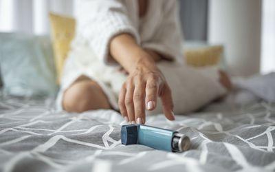 Woman reaching for inhaler