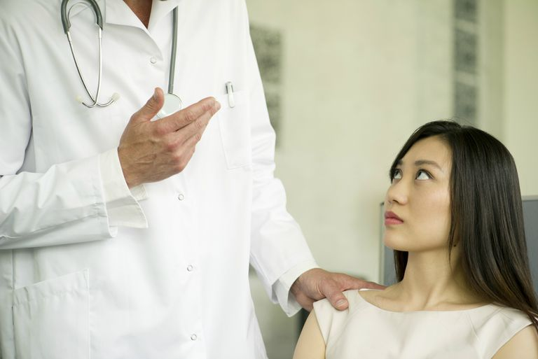 Woman receiving bad news from doctor