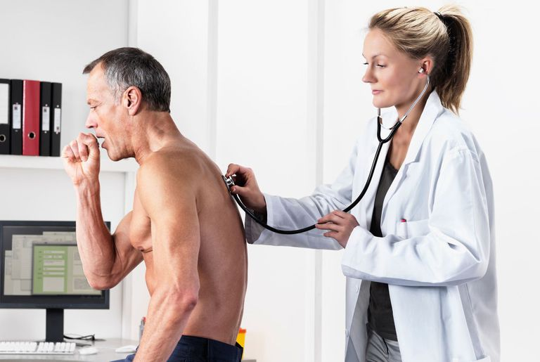 Coughing man being examined by a doctor