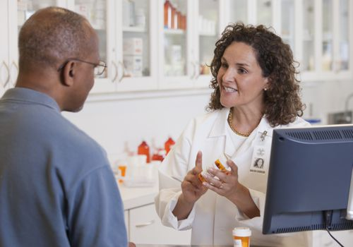 A pharmacist with her patient