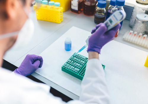 Person doing genetic testing in medical lab