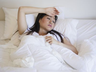 A woman in bed due to her sickness