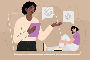 An illustration of a Black therapist with glasses talking to a young patient through a laptop screen.
