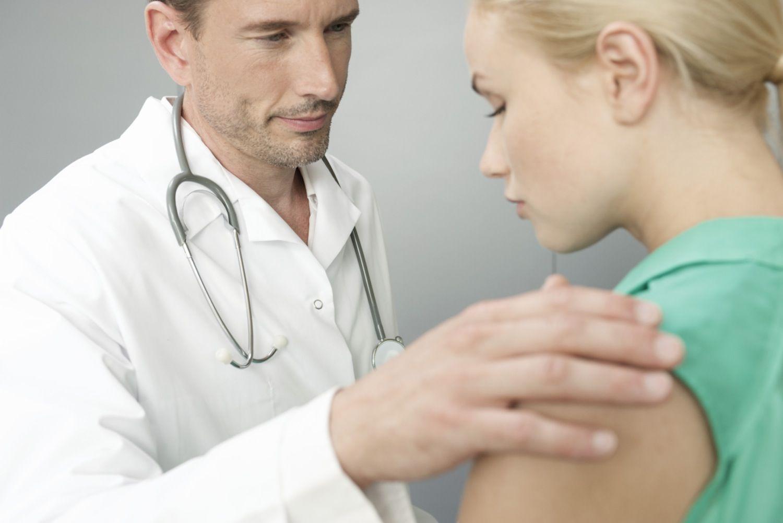 Doctor comforting upset patient