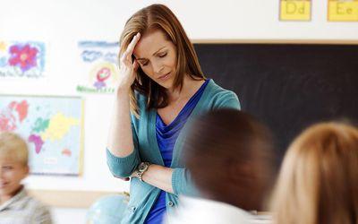 School children (8-9) with female teacher during class