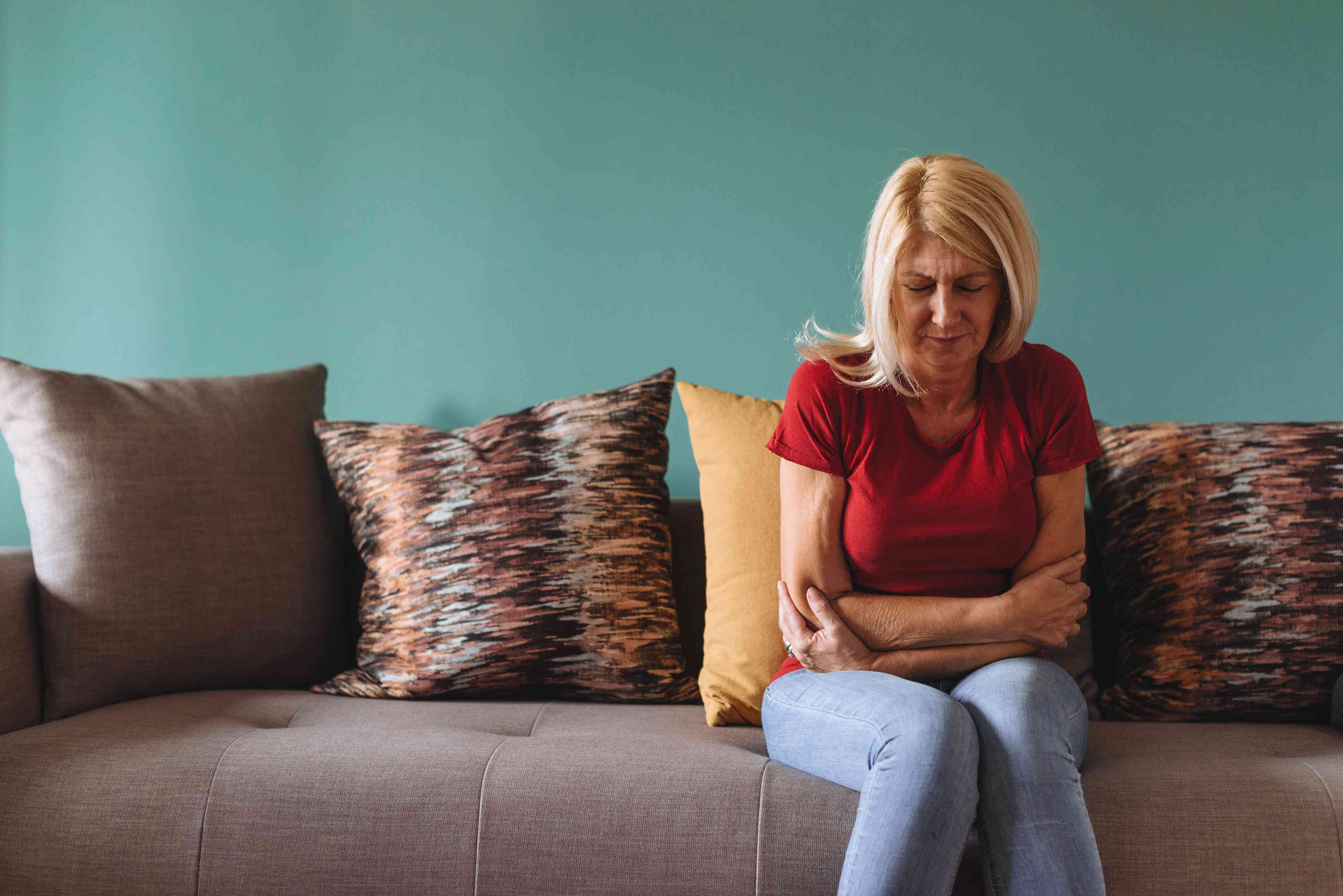 Mature woman facing pelvic pain at home