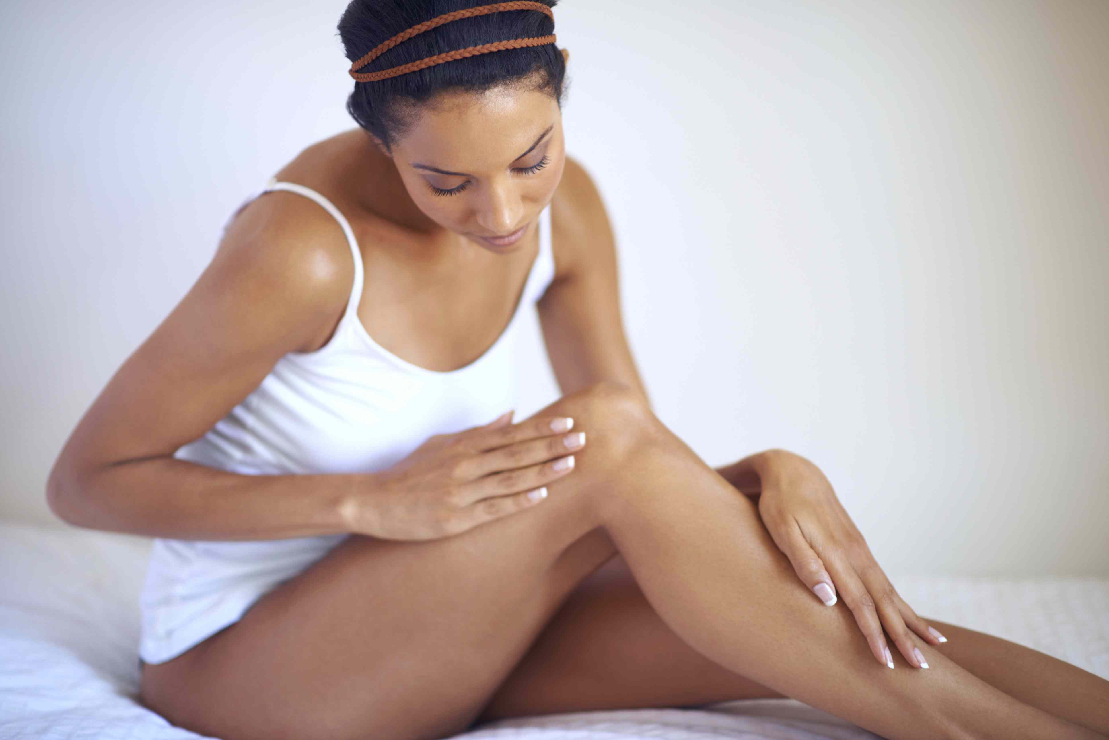 Woman examining her leg