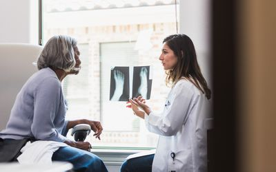 doctor discusses patient's foot x-ray