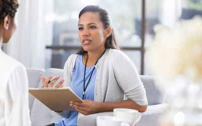 Female psychiatrist talking with female patient