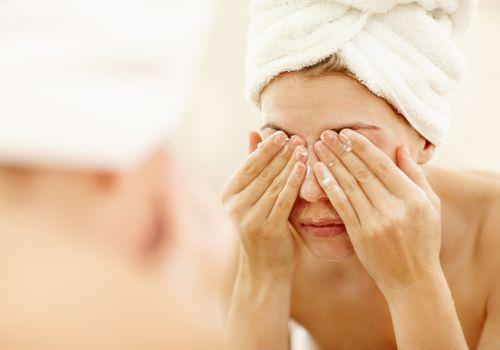 Woman washing her eyes