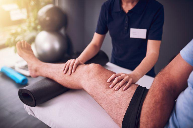 Man having his knee worked on
