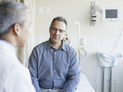 Doctor talking to patient in hospital room