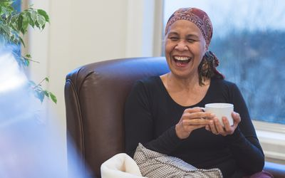 A women with cancer laughing
