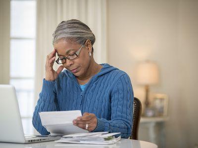 Woman sitting at a desk paying medical bills