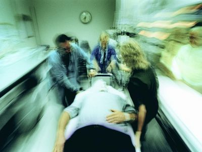 emergency room ER patient being rushed in a hospital
