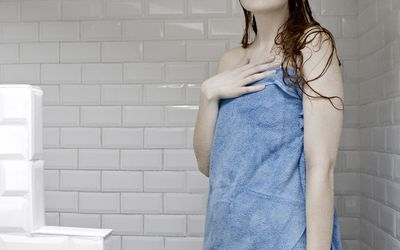 Portrait of woman wrapped in towel after a shower
