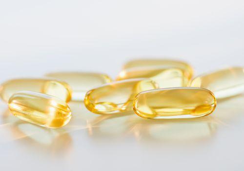 Omega fatty acid pills on white background, studio shot