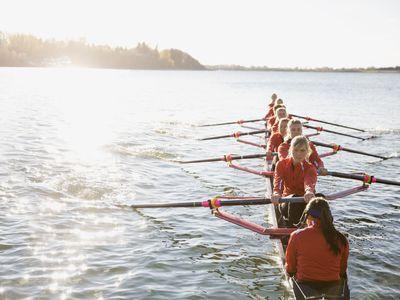 Women sitting in a canoe rowing